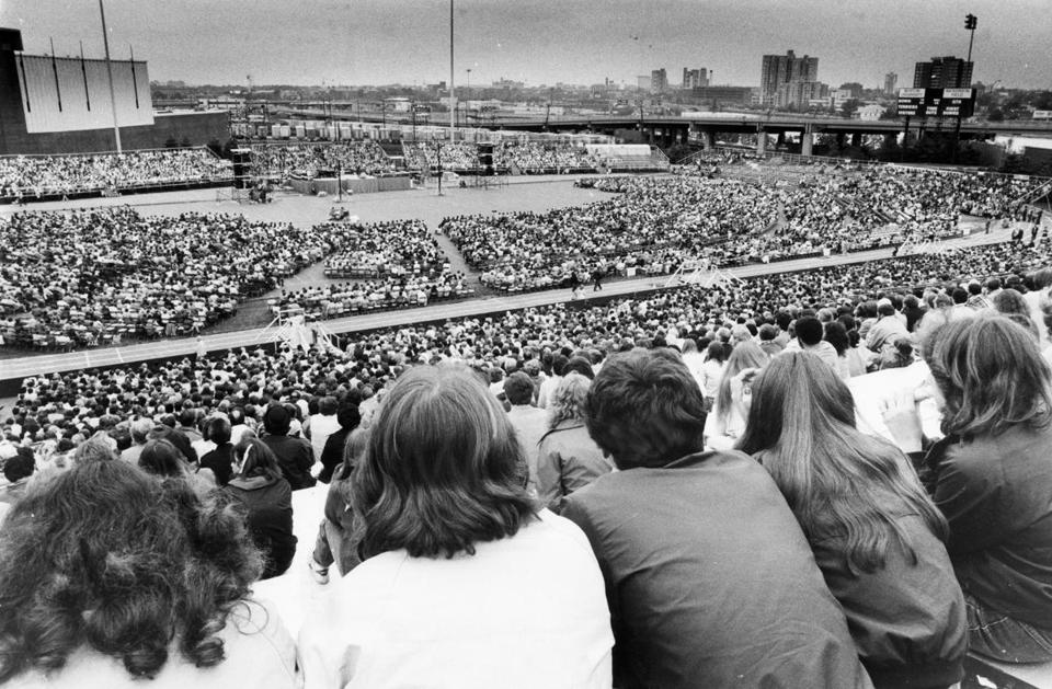 Thousands filled Boston University's Nickerson Field for the first day of Reverend Billy Graham's eight-day crusade in Boston on May 30, 1982.